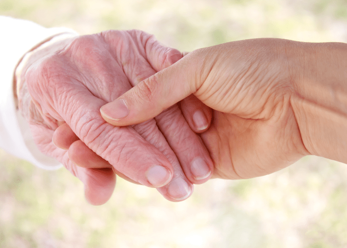 closeup-photo-of-younger-person-holding-elderly-person's-hand