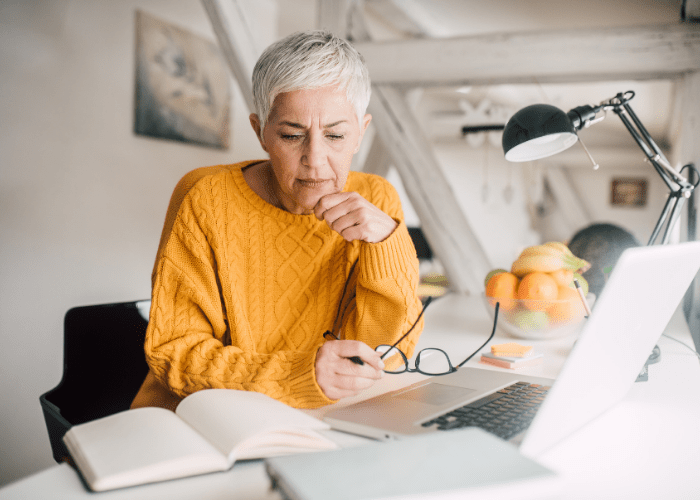 older-woman-looking-up-resources-for-family-caregivers