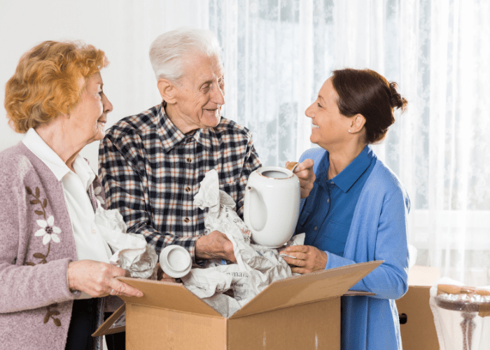 downsizing-for-seniors-older-couple-shring-memories-with-daughter