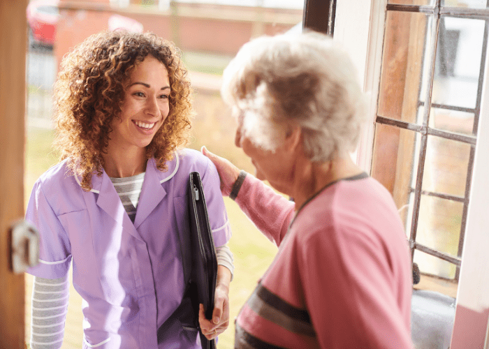 elderly-woman-welcoming-a-caregiver-into-her-home