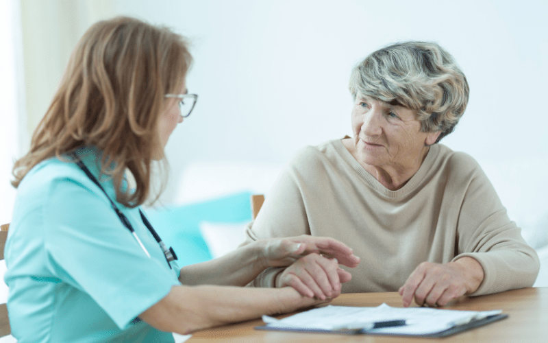 nurse-discussing-a-caregiver-care-plan-with-an-elderly-female-patient