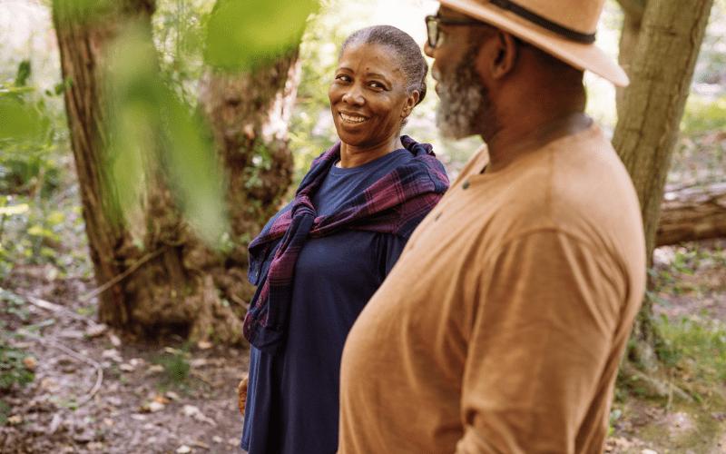 two-older-adults-on-a-nature-walk-enjoying-senior-living-in-massachusetts