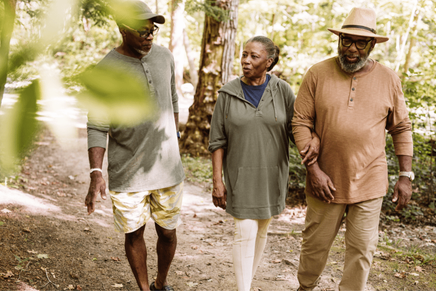 Three older adults trying walking as one of the many activities for seniors