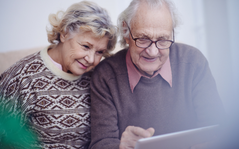older-couple-planning-an-advance-directive-on-their-tablet